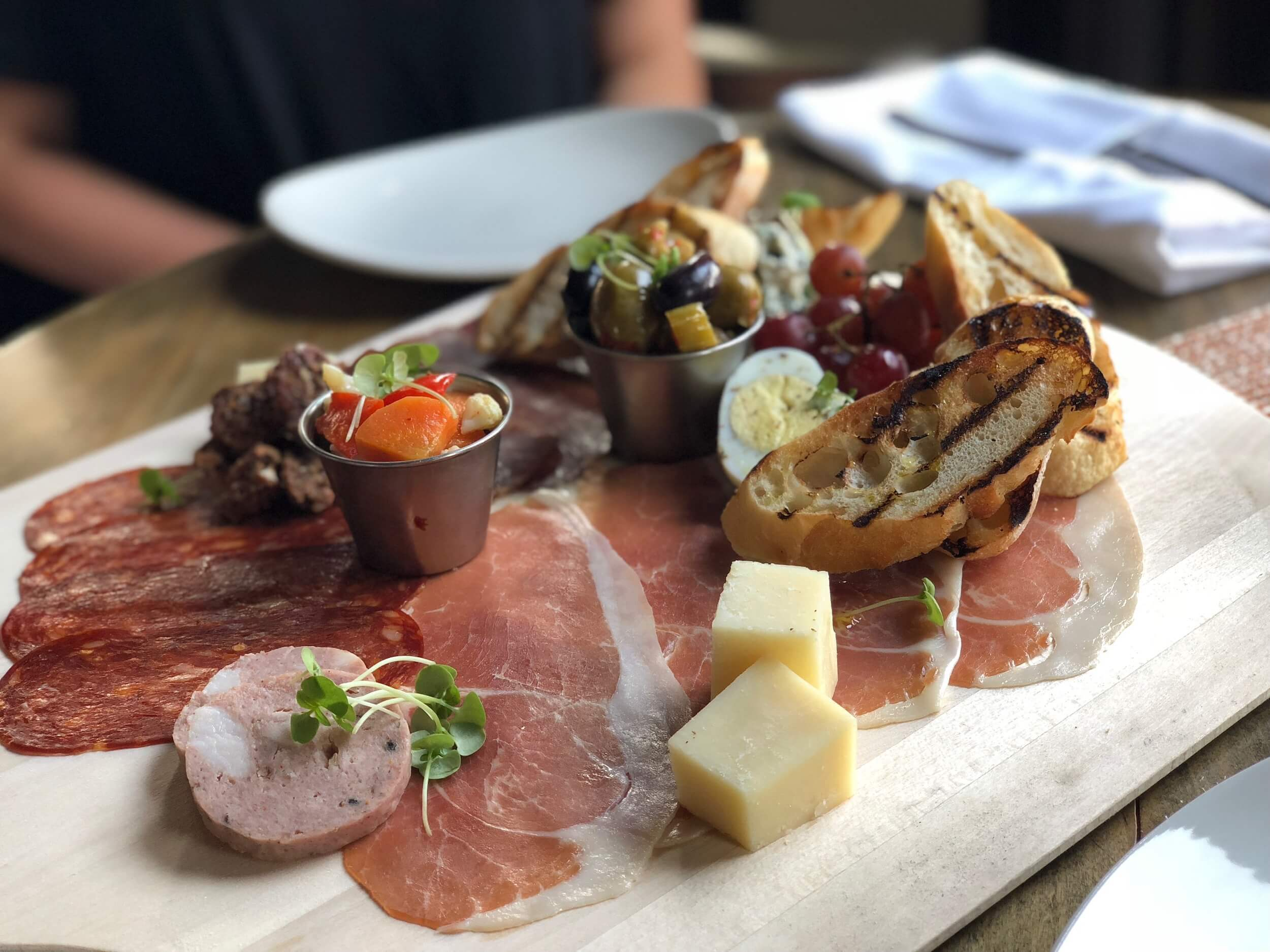Cellar Board. a selection of cured meats, artisan cheeses, marinated olives, giardinara & served with toasted baguette