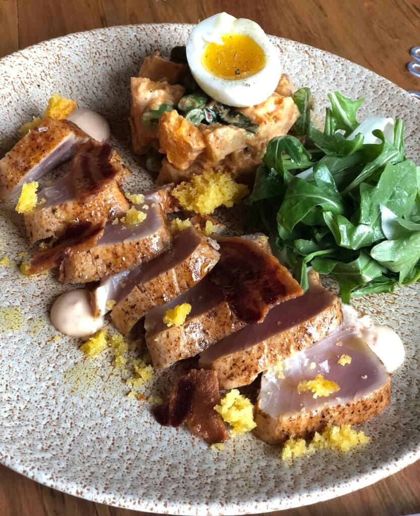 albacore tuna, sweet potato salad, 6 minute egg, cornbread, bacon & greens